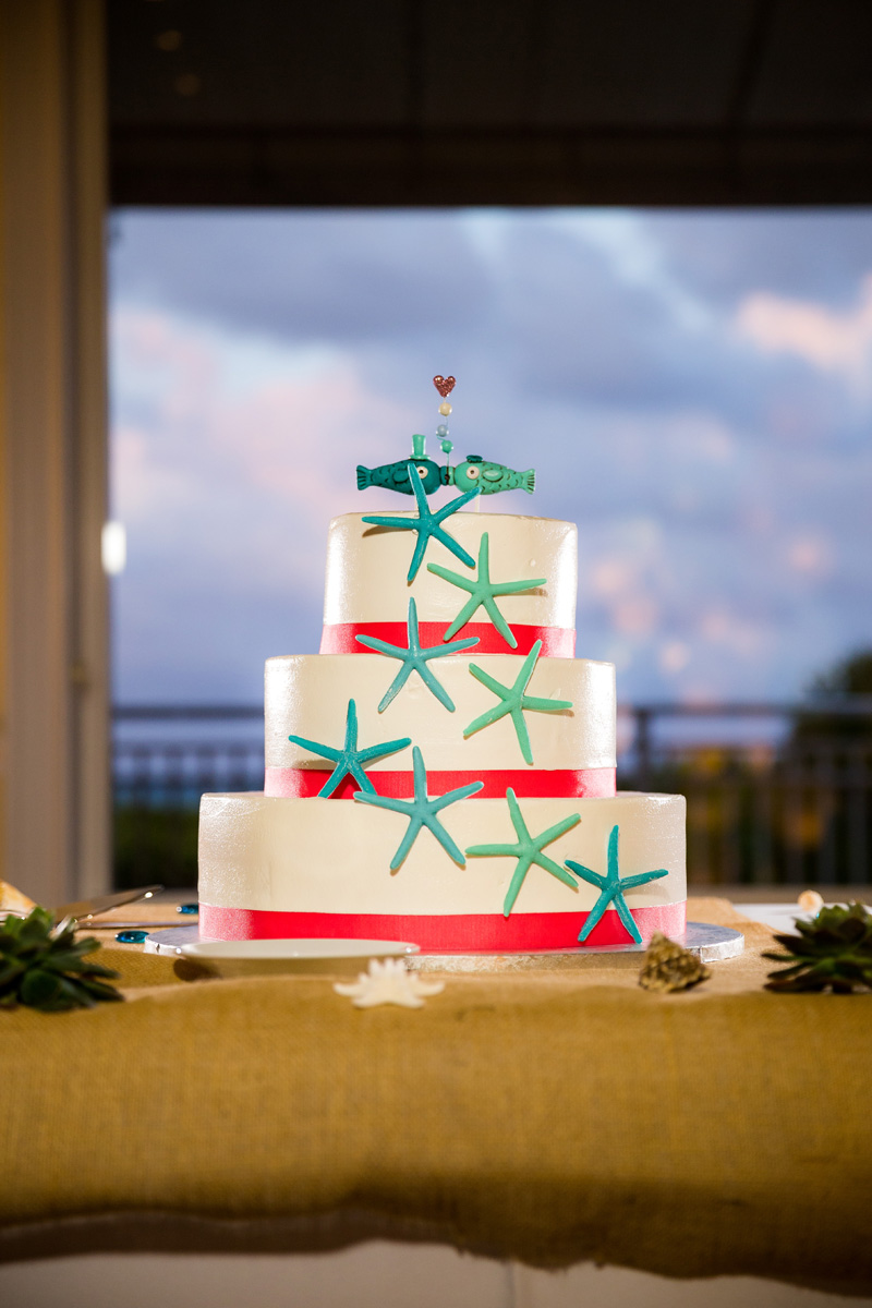 Elegant White Wedding Cake with Chocolate Starfish and Fish Cake Topper | The Majestic Vision Wedding Planning | Palm Beach Shores Community Center in Palm Beach, FL | www.themajesticvision.com | Chris Kruger Photography