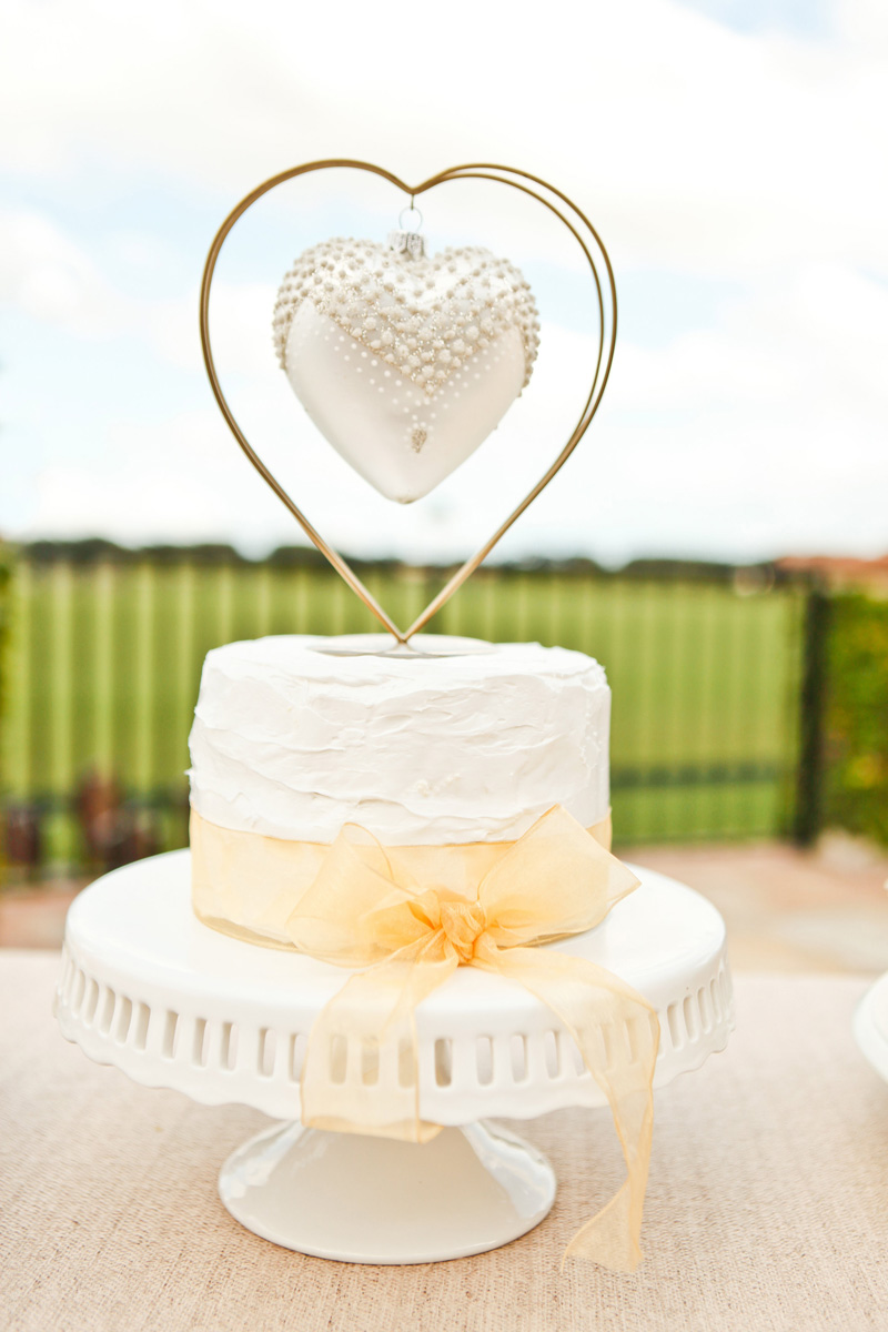 Simple White Buttercream Wedding Cake | The Majestic Vision Wedding Planning | International Polo Club in Palm Beach, FL | www.themajesticvision.com | Krystal Zaskey Photography