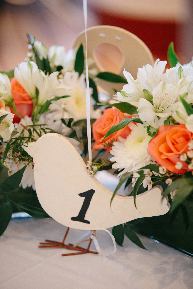 Modern Centerpieces with White Roses and Orange Roses and Bird Table Number | The Majestic Vision Wedding Planning | Marriott Singer Island in Palm Beach, FL | www.themajesticvision.com | Robert Madrid Photography
