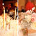 Romantic Centerpiece with Blush Roses, White Roses and Dusty Miller at 32 East in Palm Beach, FL thumbnail