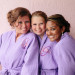 Elegant Bridesmaids in Matching Purple Bathrobes at Sailfish Marina in Palm Beach, FL thumbnail