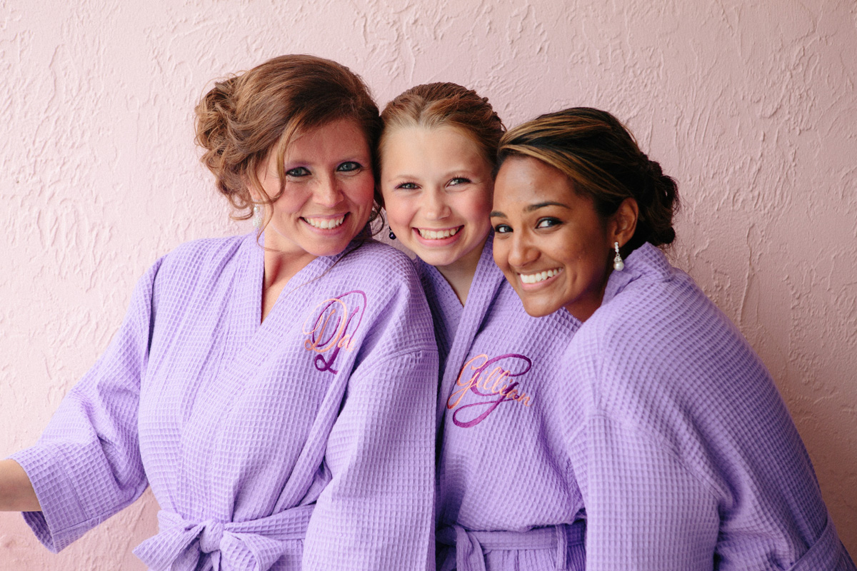 Elegant Bridesmaids in Matching Purple Bathrobes | The Majestic Vision Wedding Planning | Sailfish Marina in Palm Beach, FL | www.themajesticvision.com | Robert Madrid Photography