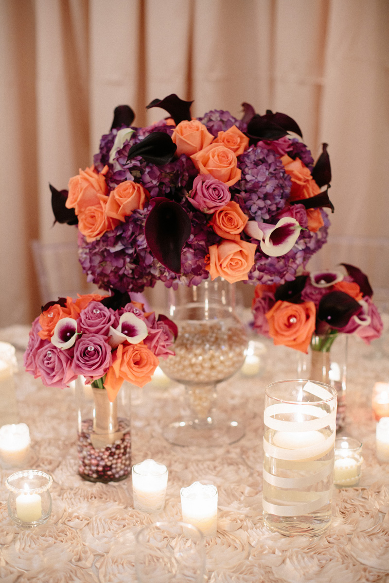 Elegant Centerpiece with Purple Roses, Coral Roses and Calla Lillies | The Majestic Vision Wedding Planning | Sailfish Marina in Palm Beach, FL | www.themajesticvision.com | Robert Madrid Photography