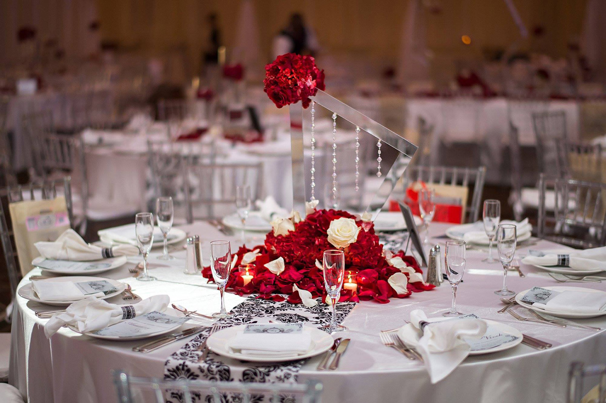 Elegant Geometric Mirror Centerpiece with Red Roses for Indian Wedding Reception | The Majestic Vision Wedding Planning | PGA National in Palm Beach, FL | www.themajesticvision.com | Haring Photography