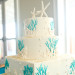 Whimsical Wedding Cake with Coral and Starfish at Palm Beach Shore in Palm Beach, FL thumbnail