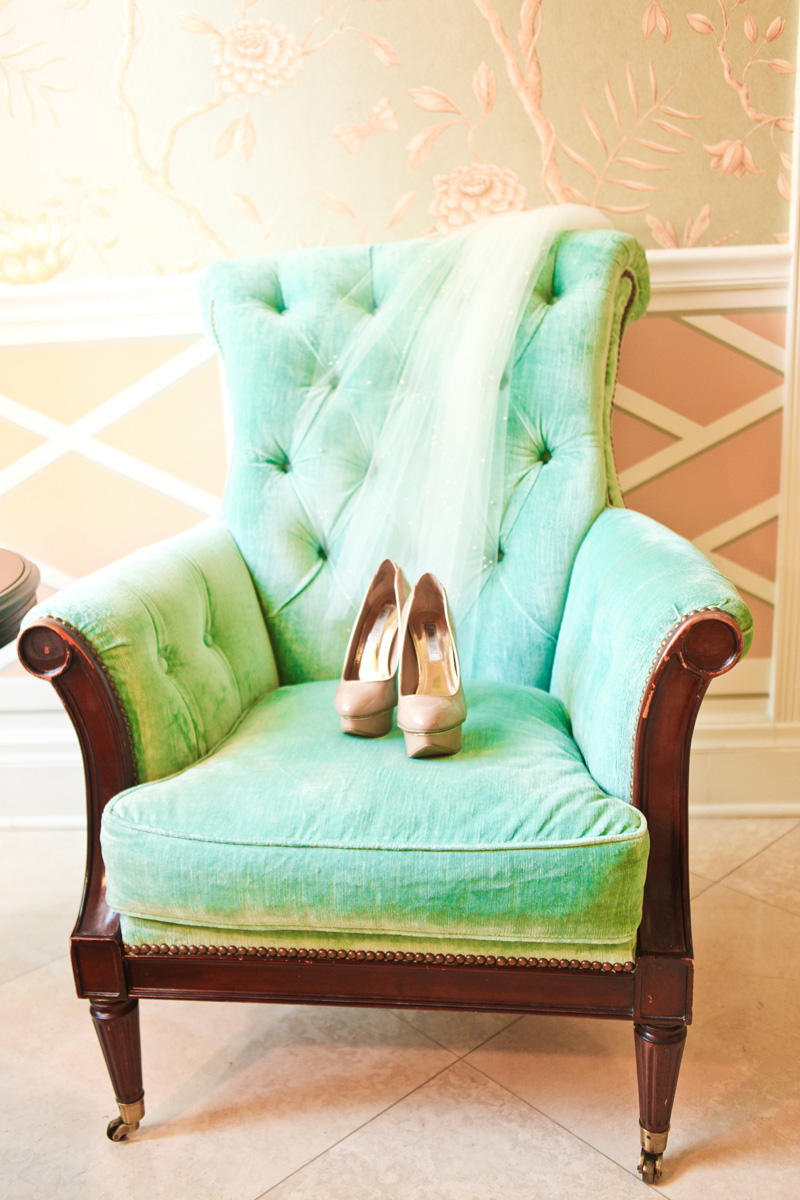Elegant Gold Shoes and Veil on Aqua Armchair | The Majestic Vision Wedding Planning | The Colony Hotel in Palm Beach, FL | www.themajesticvision.com | Krystal Zaskey Photography