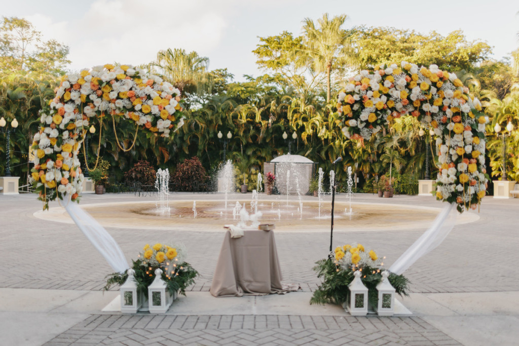 Heart Shaped Ceremony Arch Covered in Orange, Yellow and White Roses | The Majestic Vision Wedding Planning | Palm Beach Zoo in Palm Beach, FL | www.themajesticvision.com | Robert Madrid Photography