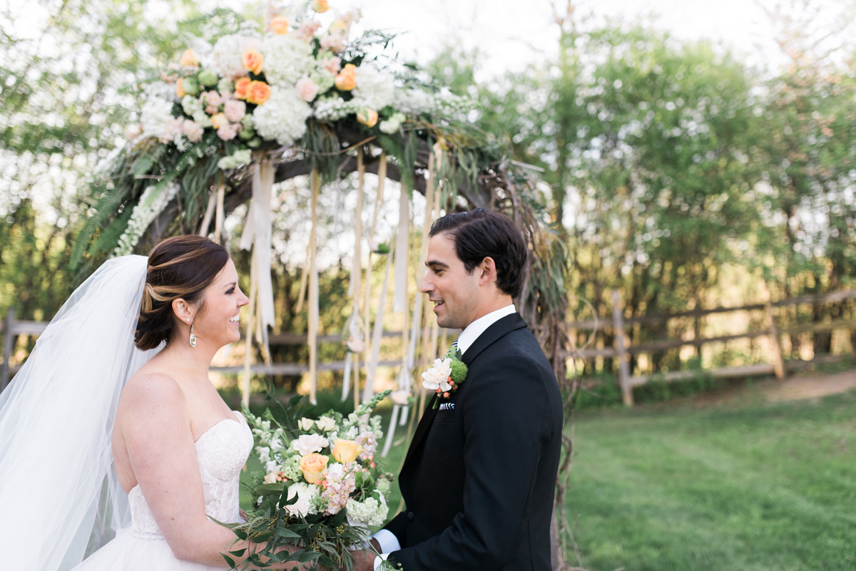 Elegant Ceremony Arch with Cream, Blush and Pink Flowers   The Majestic Vision Wedding Planning   Rustic Manor in Milwaukee, WI   www.themajesticvision.com   Elizabeth Haase Photography