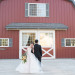 Beautiful Bride in Blush Tara Keely Gown With Handsome Groom in Front of Barn at Rustic Manor in Milwaukee, WI thumbnail
