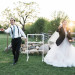 Bride and Groom Playing Fun Lawn Games During Cocktail Hour at Rustic Manor in Milwaukee, WI thumbnail