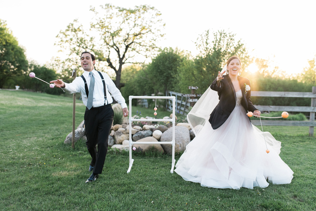 Bride and Groom Playing Fun Lawn Games During Cocktail Hour   The Majestic Vision Wedding Planning   Rustic Manor in Milwaukee, WI   www.themajesticvision.com   Elizabeth Haase Photography